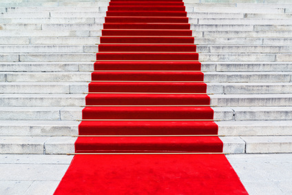 Red carpet on staircase marking the route taken by celebrities on ceremonial events